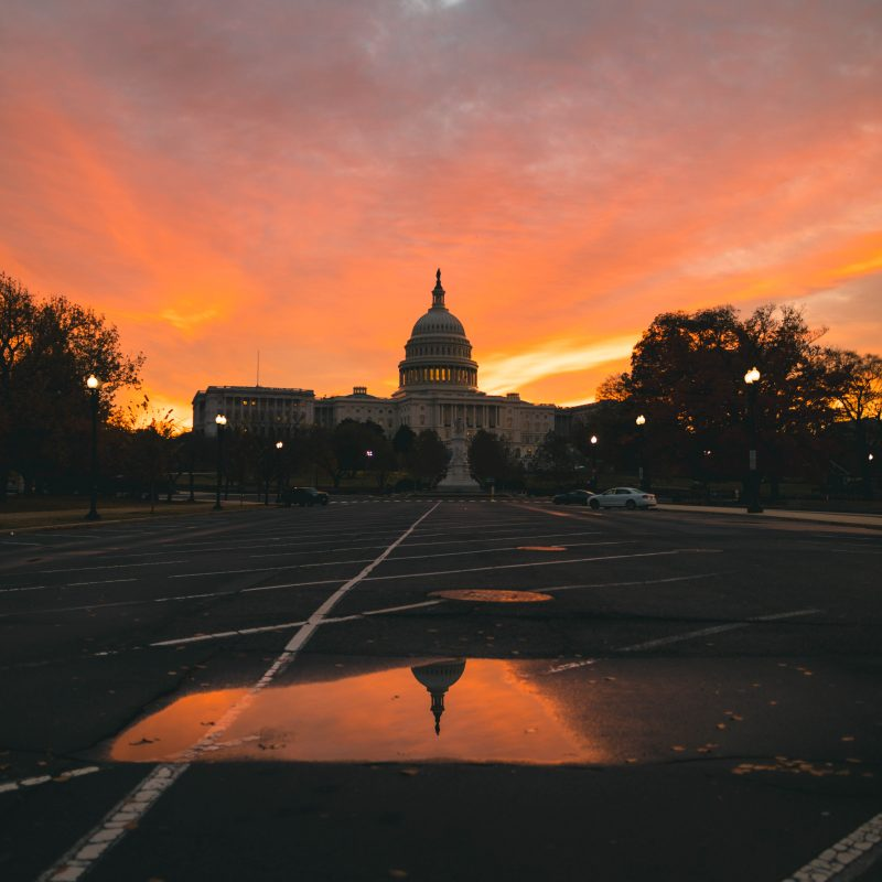 Us Captiol Sunrise Puddle Reflection