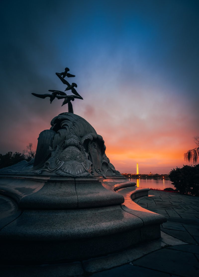 Sunrise at the Navy - Merchant Marine Memorial in Washington DC with Washington Monument in the background